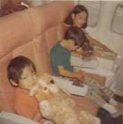 (L to R): Younger brother Kurt & his Teddy bear, myself, and older sister C.J., on an Aloha Airlines flight to Maui. (c. 1969)