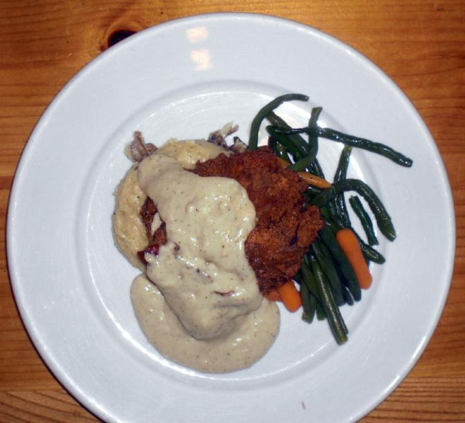 If you want comfort food, try the Southernmost Buttermilk Chicken ($18). The fried chicken and mashed potatoes are smothered in gravy and come with a side of vegetables.