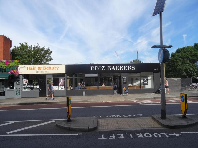 Customers get their hair trimmed for only £10 at Ediz Barbers in Greenwich.